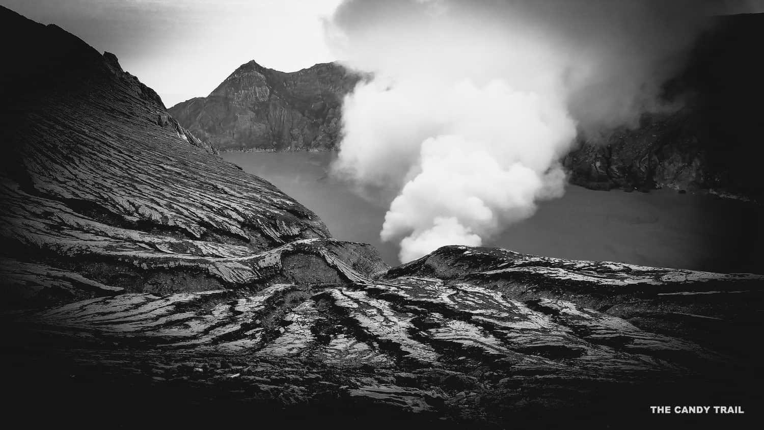 kawah ijen volcano smoking crater indonesia black and white photograph