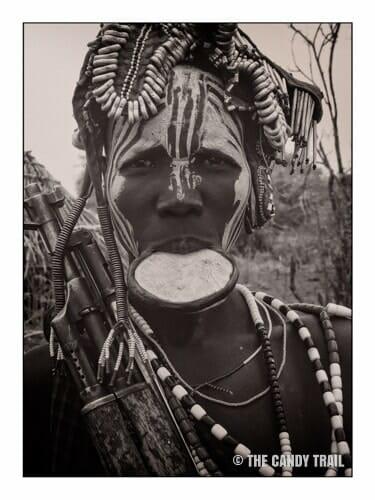 lip-plate-gun-woman-mursi-tribe-ethiopia