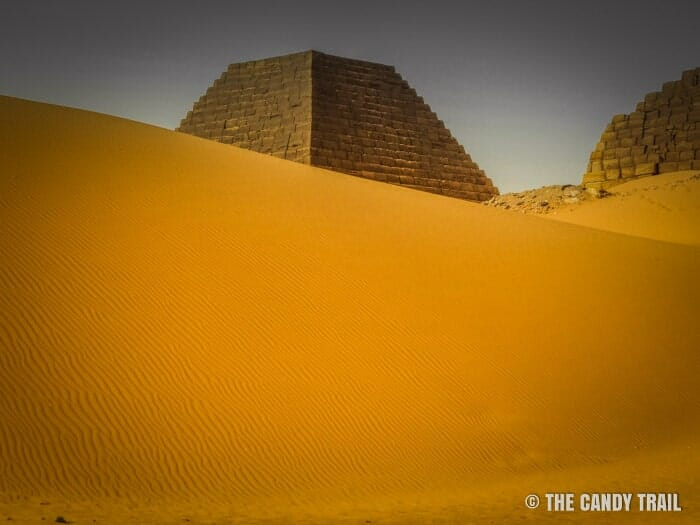 Sand dunes creeping up upon the Sudanese pyramids of Meroe.