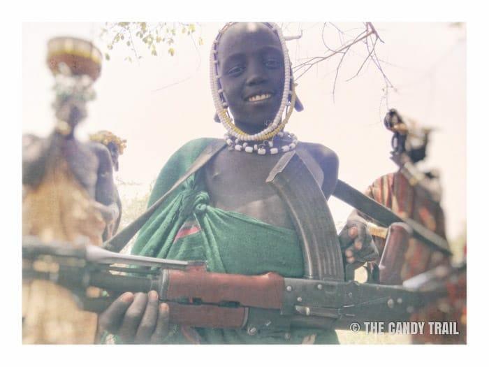mursi tribe kid with gun ethiopia