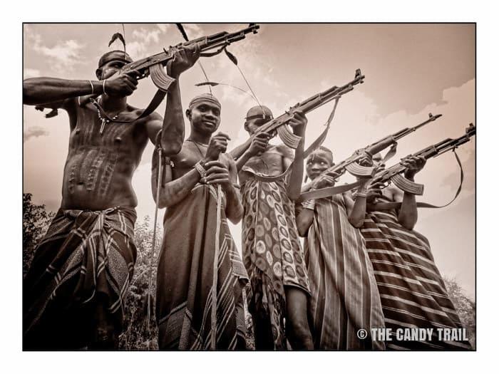 mursi tribesmen ak47 guns pointed ethiopia