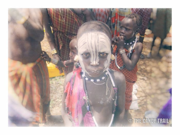 painted face kid mursi tribe ethiopia