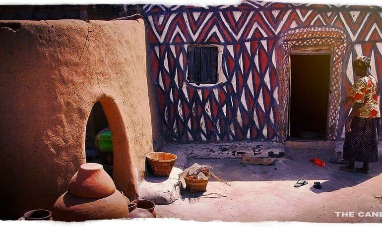 woman painted house courtyard sirigu ghana