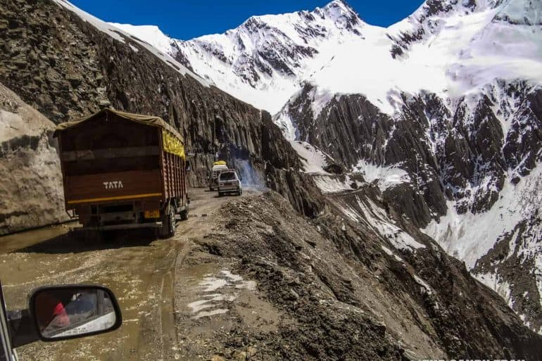 leh-highway-trucks-on-mountain-road