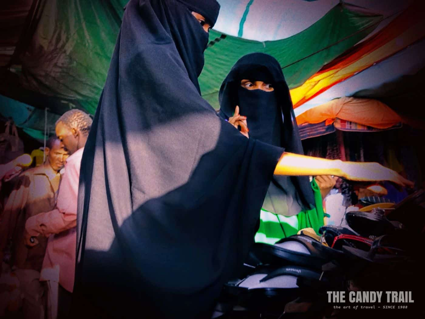 At the Hargeisa market: women checking out shoes.