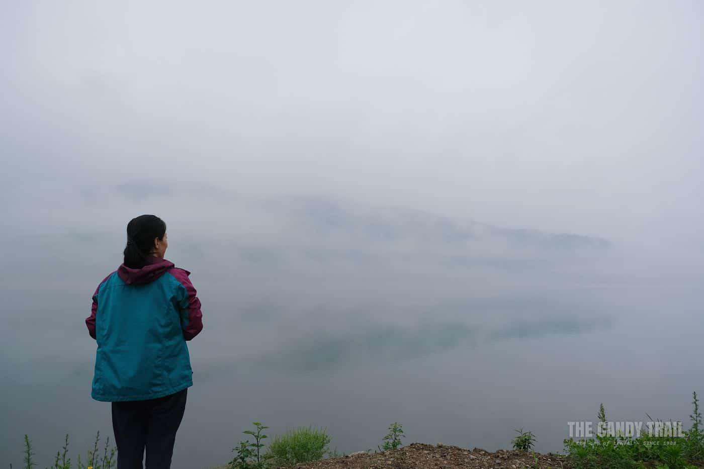 Woman Looking Towards North Korea Across Yalu River China