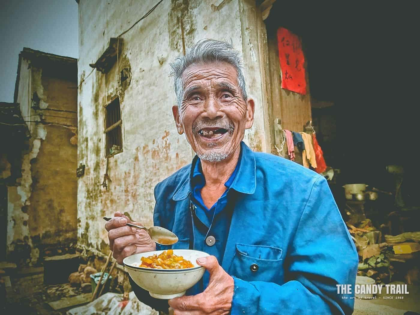 Old Chinese Guy Eating Noodles