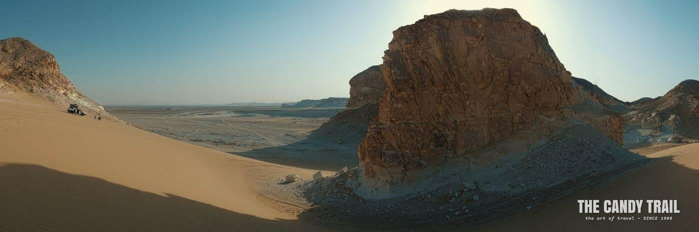 4WD vehicle in dunes amid rock hills on white desert egypt trip