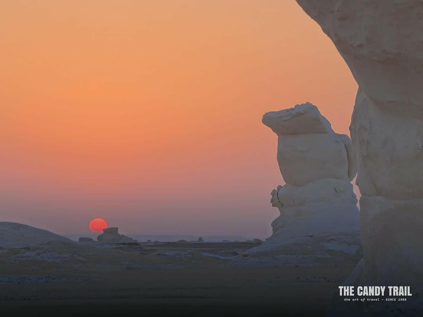 red sunset white desert rock formations egypt