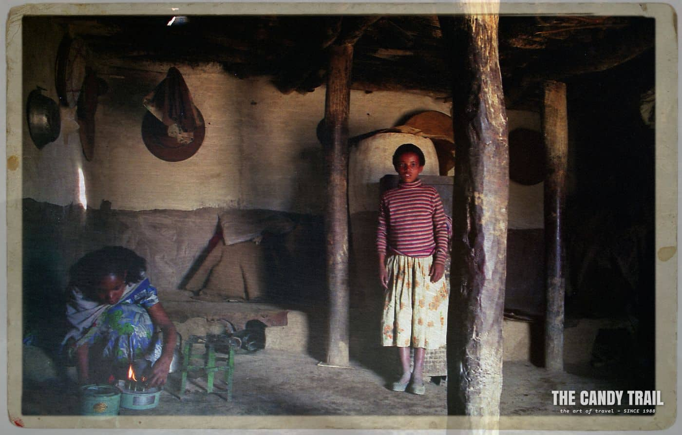 Inside the house and Mamayta prepares a fire for tea