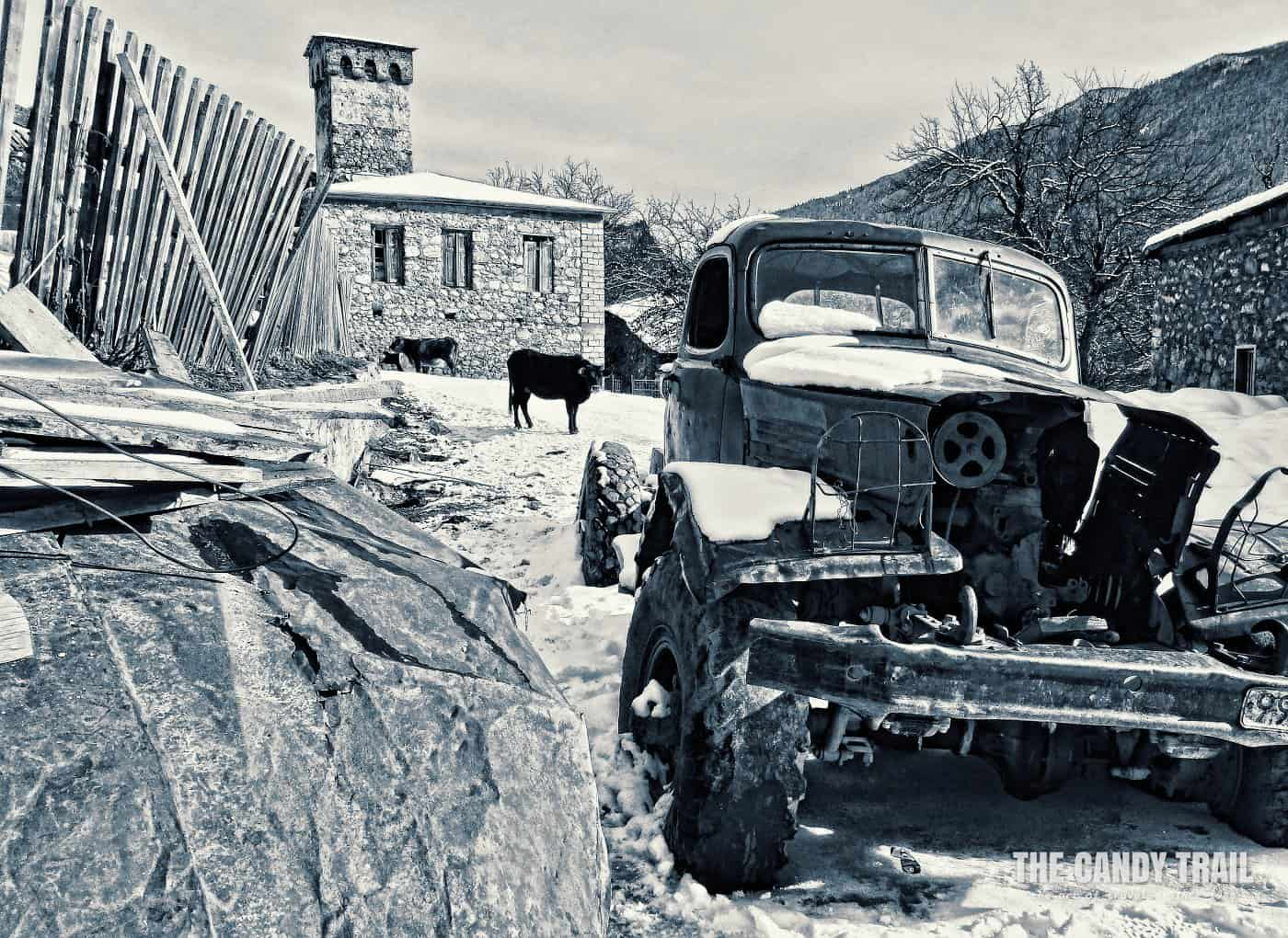 Wrecked Soviet truck in backstreets of Mestia in Winter.