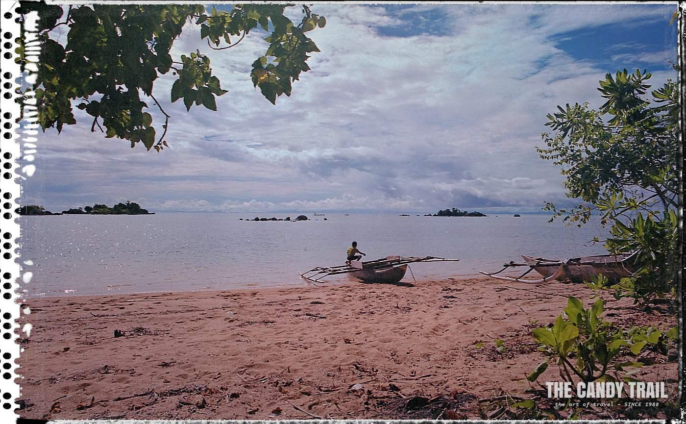 canoe on beach sarong papua indonesia 1999