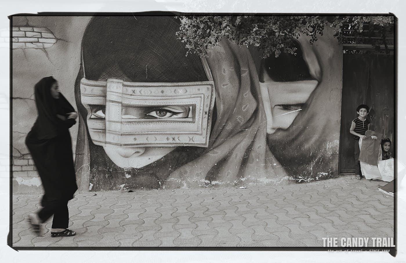 masked women city mural iran