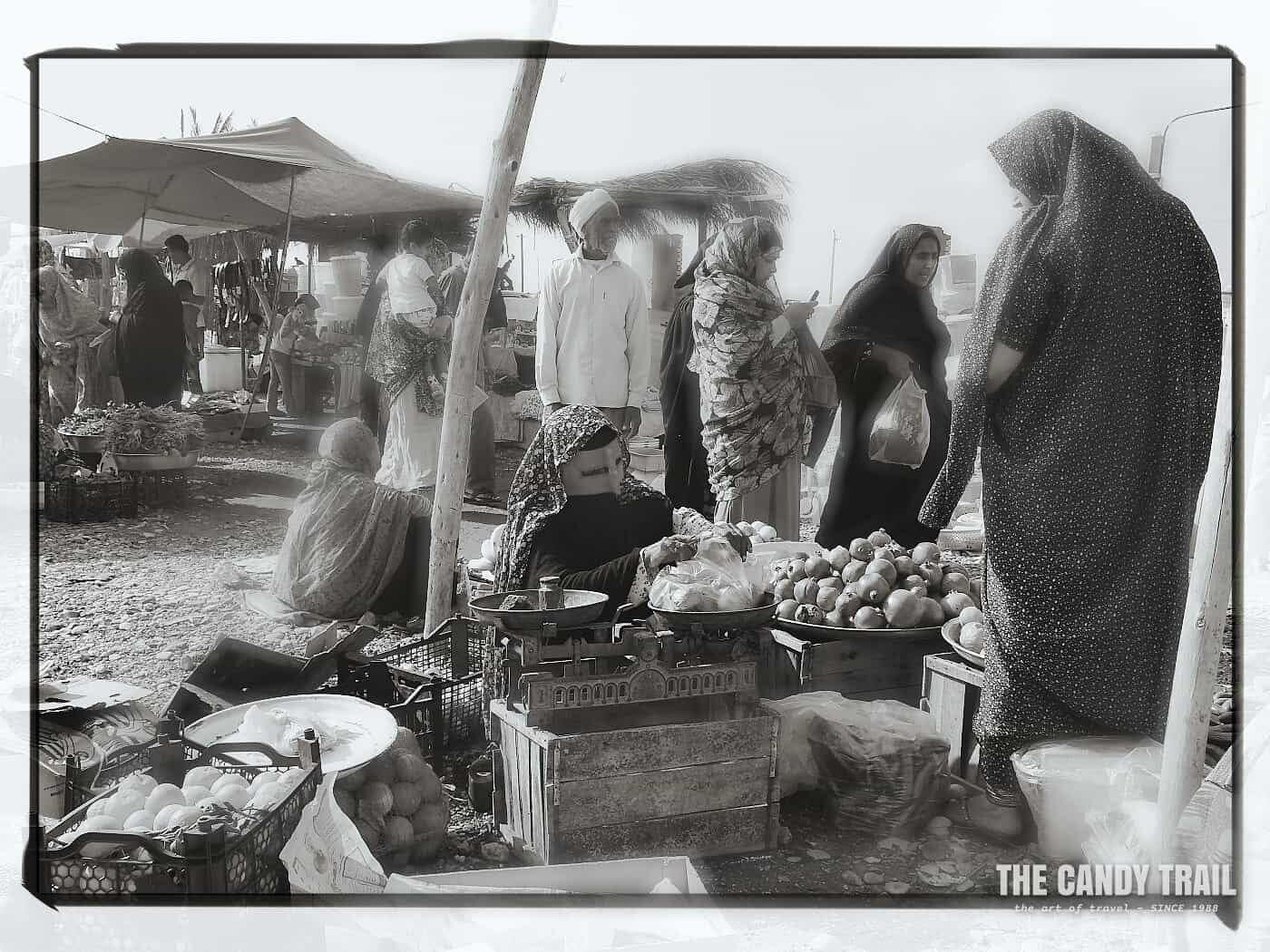 masked women market vendor iran 2