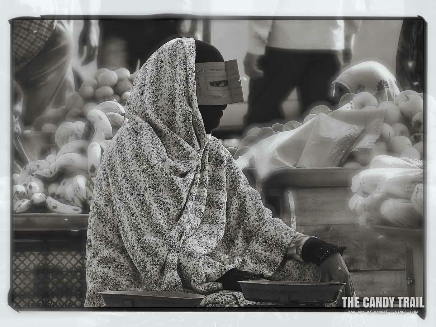masked women food vendor minab market