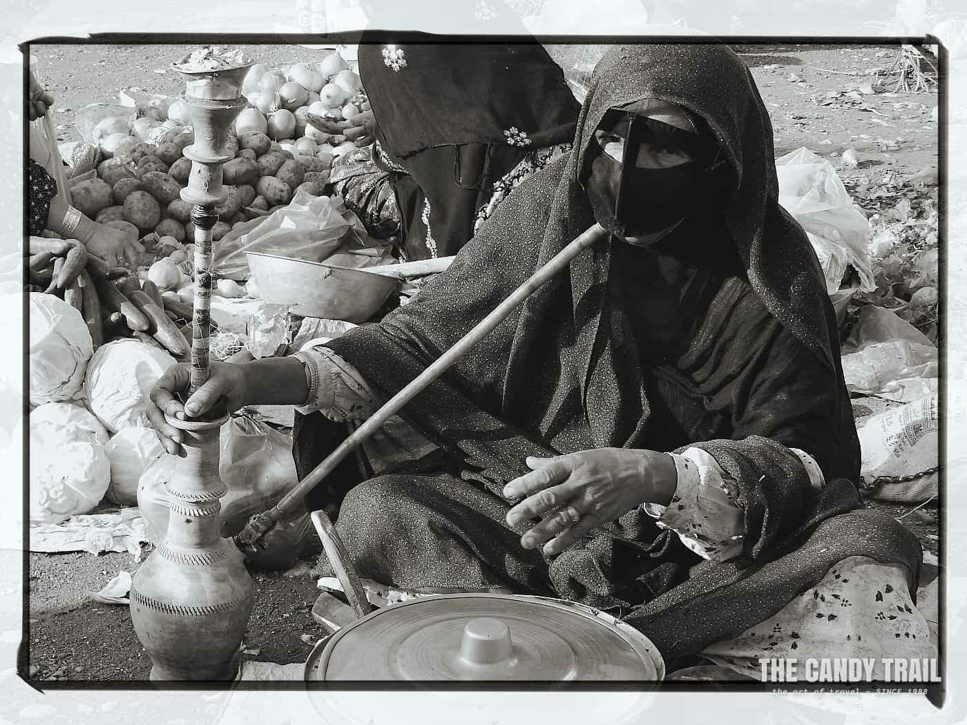 masked women smoking waterpipe iran