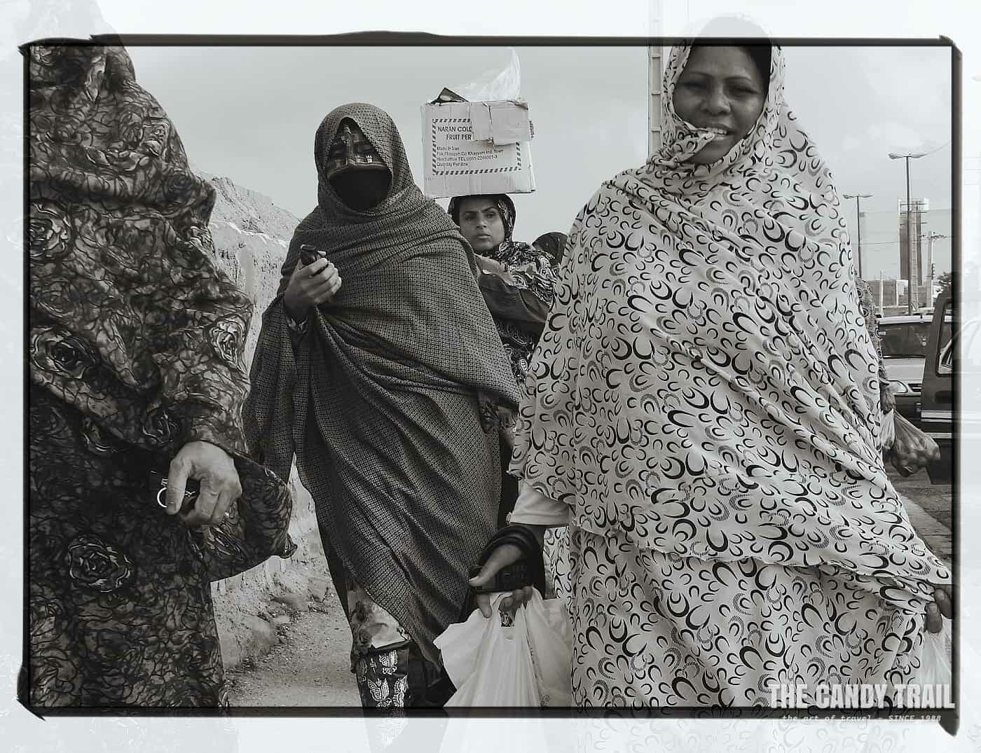 Women with shopping leave the Minab Market
