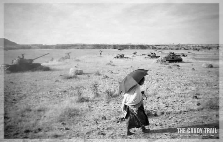 woman-passing-tank-axum-ethiopia
