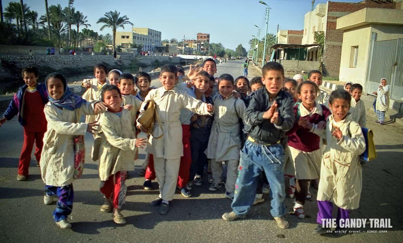 kids crowd street saqqarra egypt