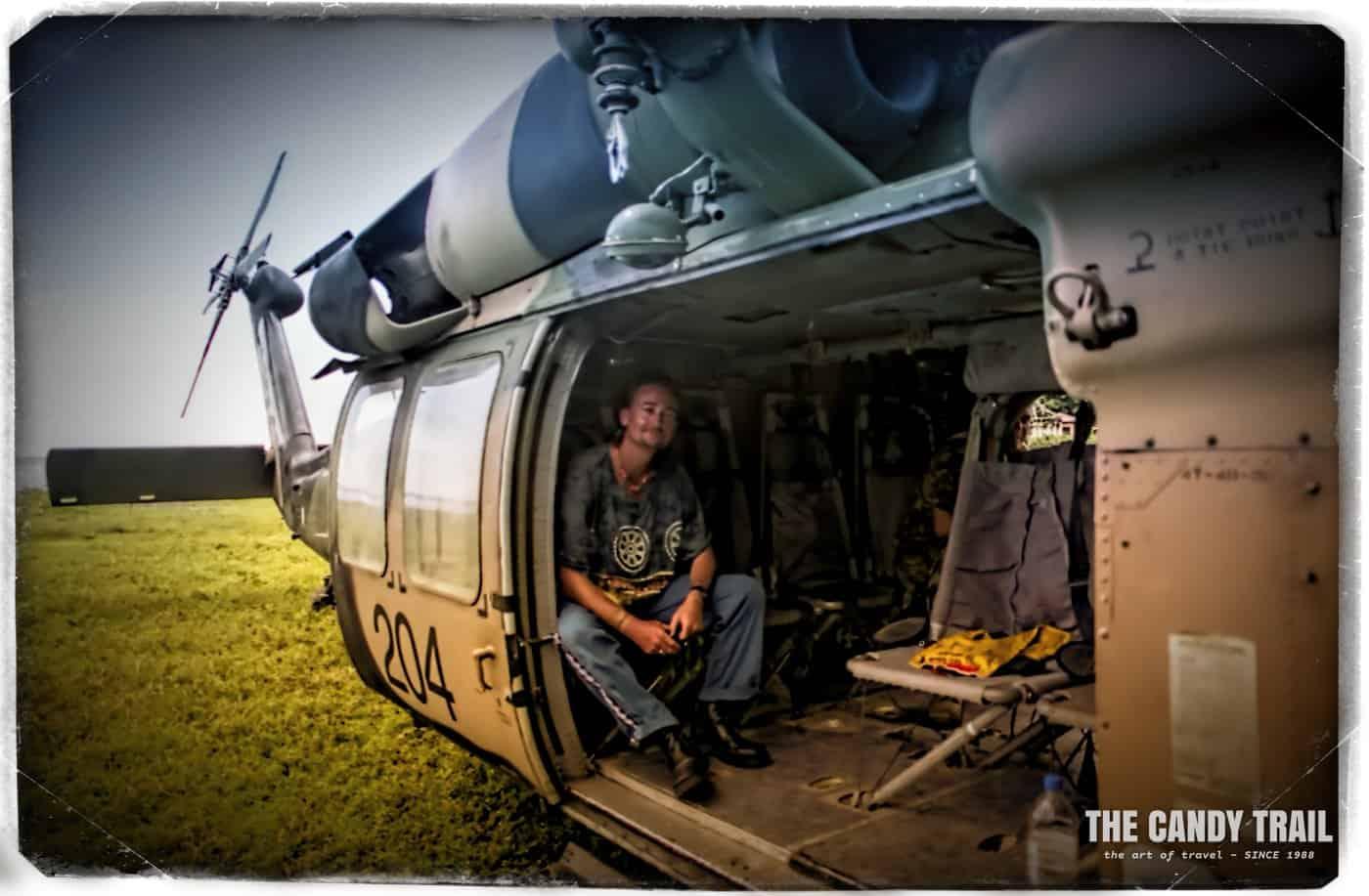 Michael Robert Powell long term traveler in Blackhawk helicopter East Timor 2000