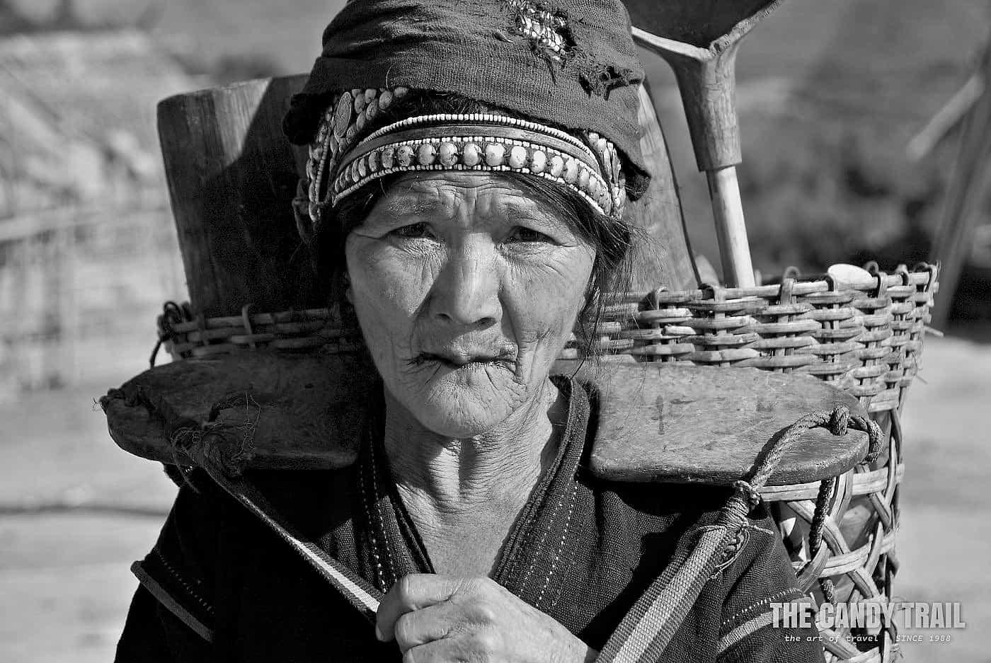 Portrait of elderly Akha tribal woman with basket