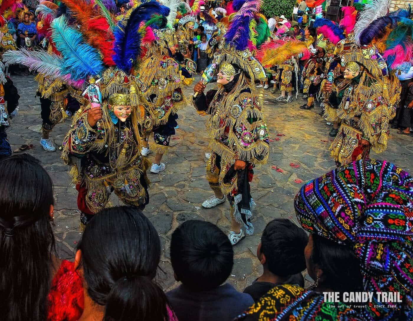 masked performers San Francisco de Asis festival in guatemala