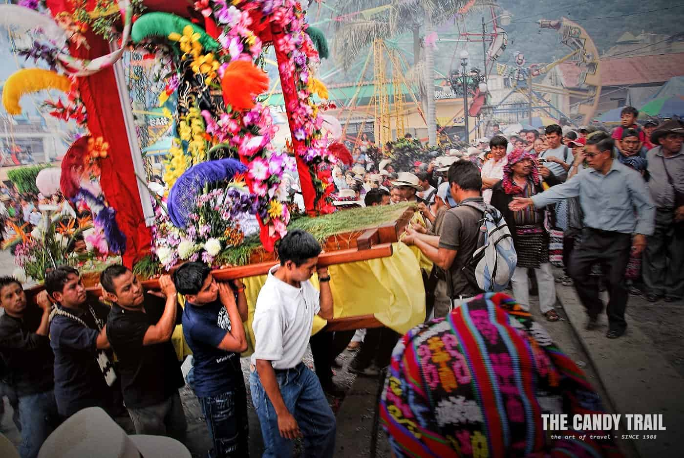 San Francisco de Asis statue being carried into church by Mayan men