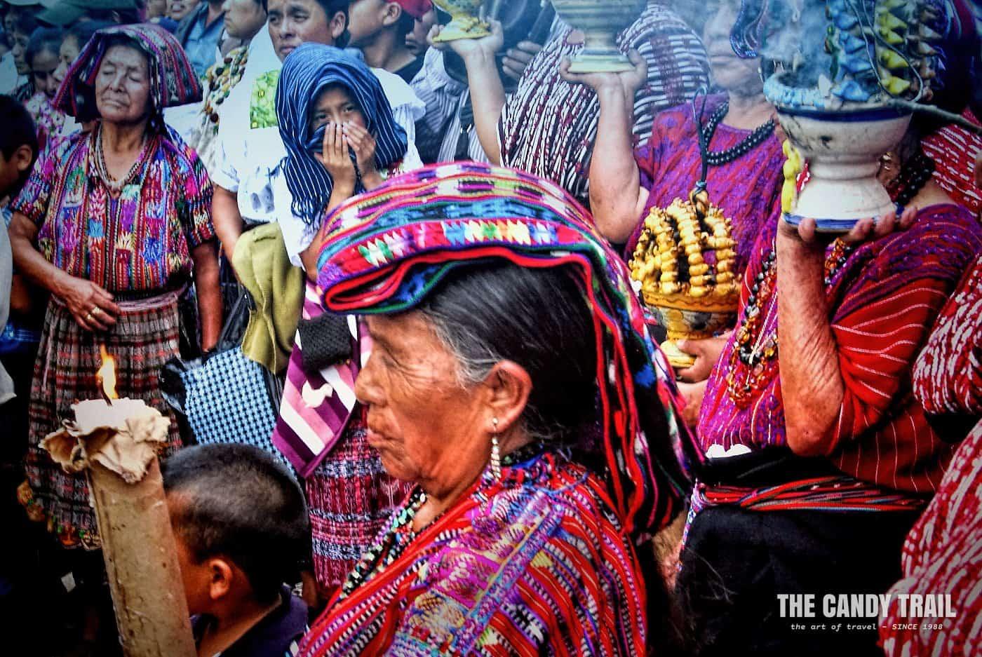 maya women pray at festival in guatemala