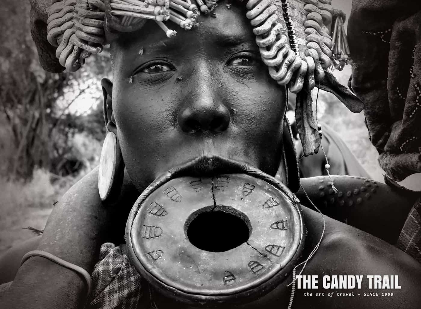 mursi tribe woman with lip plate in ethiopia
