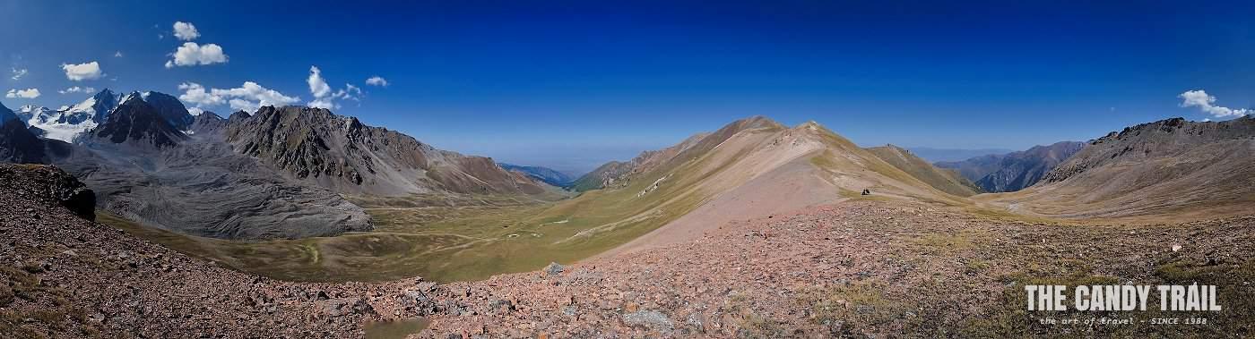 panorama of mountains on ala kul trek by horse
