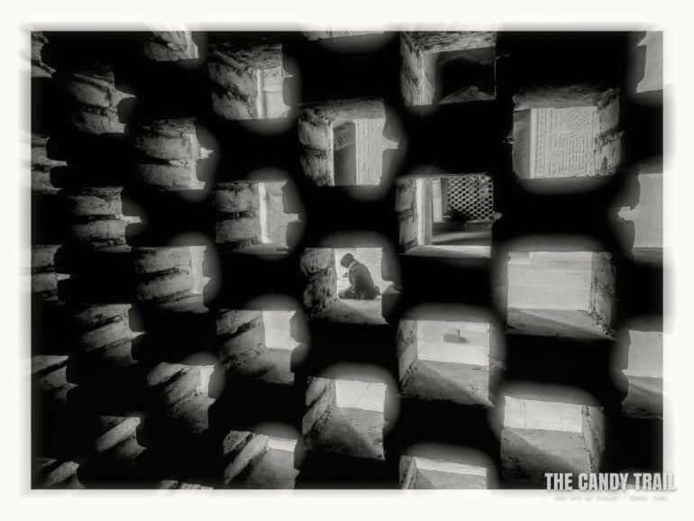 student-amid-wall-pattern-iran