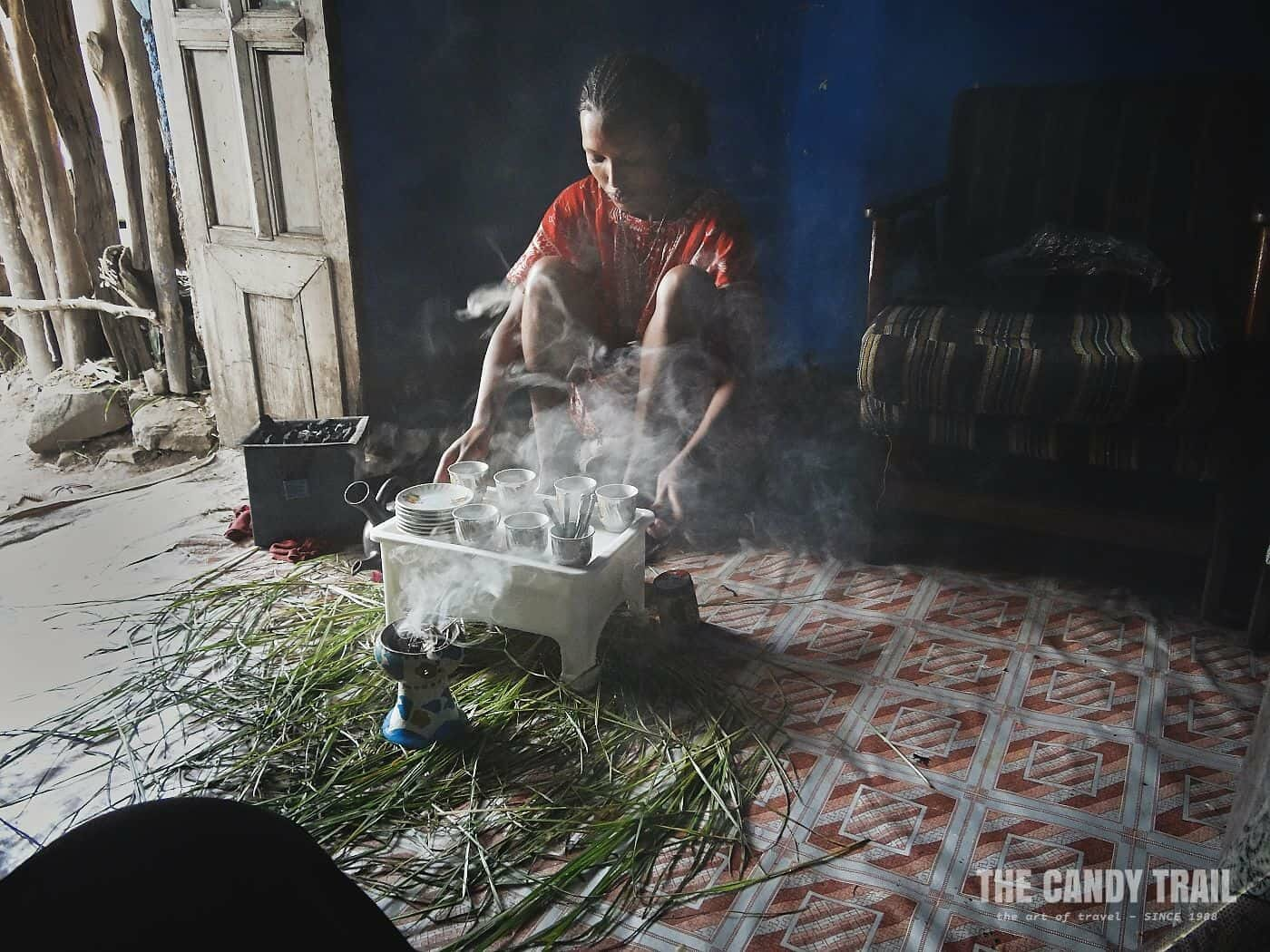 woman making traditional coffee in gondar ethiopia